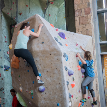 students_rock_climbing
