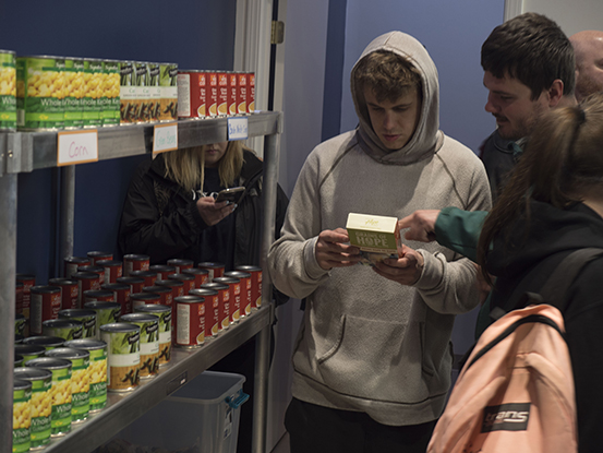 Student Picking out Food from Lobos Pantry